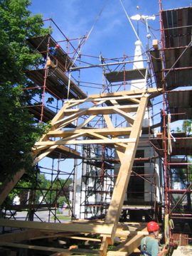 One bent of the clock tower frame, being lifted by a crane