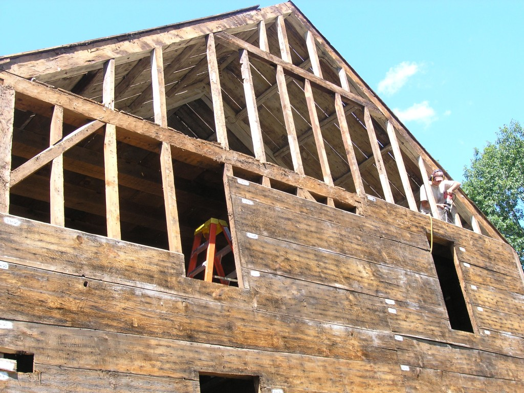 Dave, removing sheathing from the Demeritt-O'Kane House