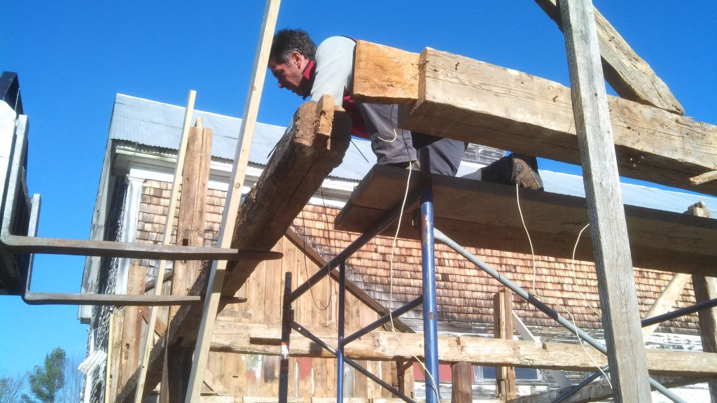 Corner post removed, Scott leaning on loft girt, end of tie beam exposed