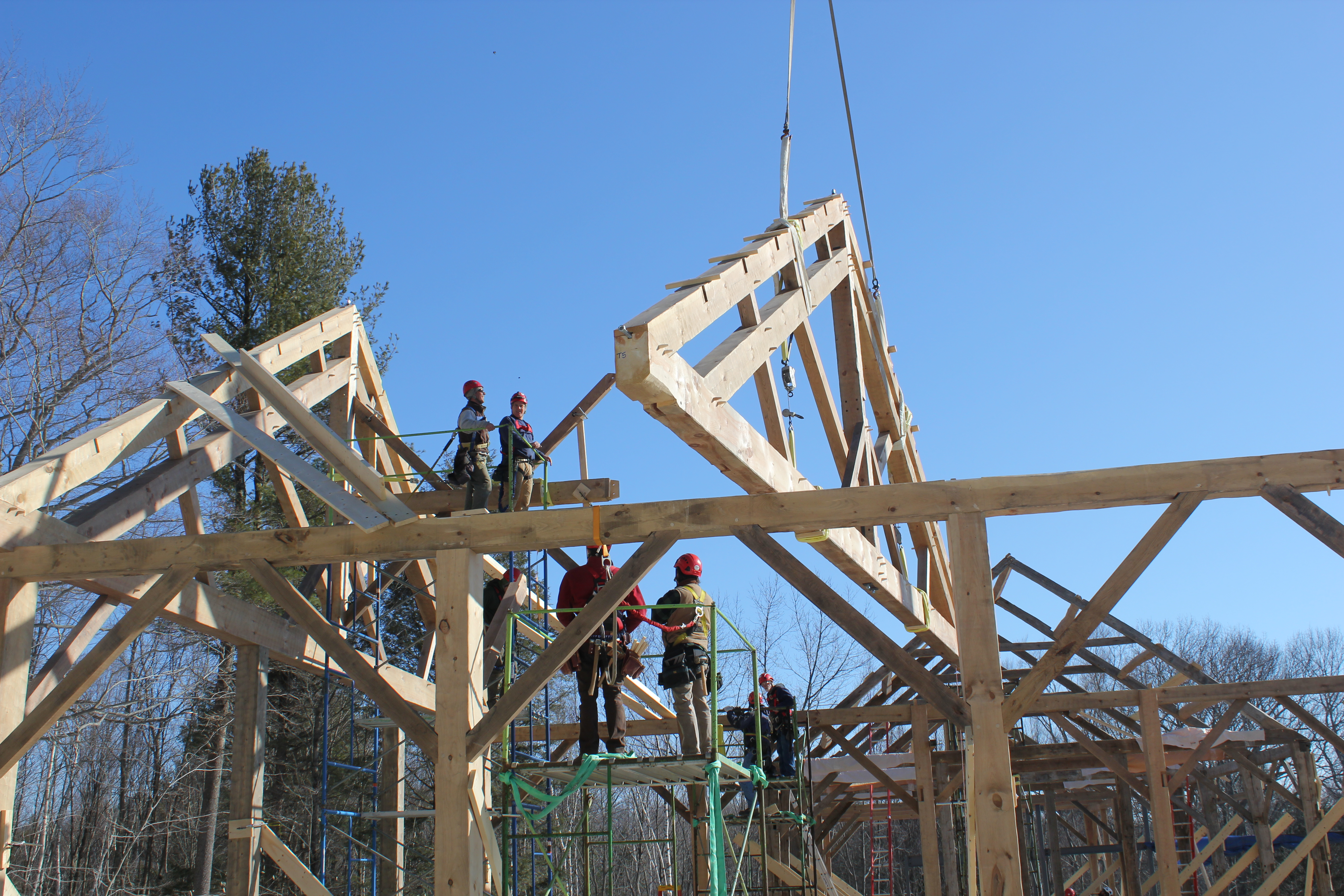 Installing meetinghouse truss on crane day. One of many (cranes days, and trusses)
