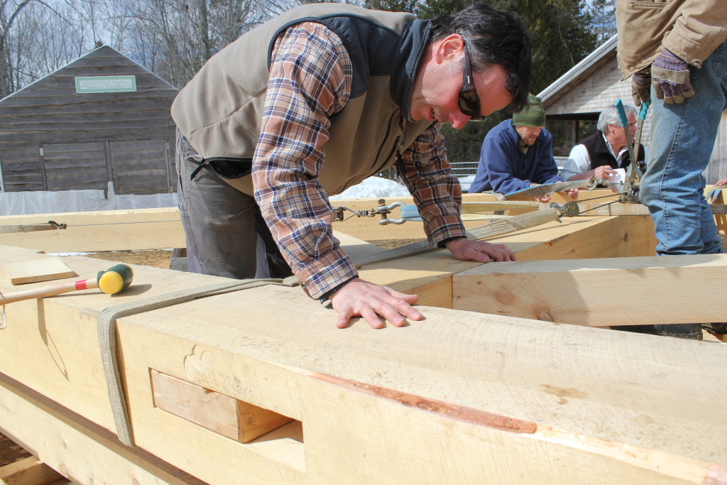 Scott Lewis checks the fit of the half dovetail joint