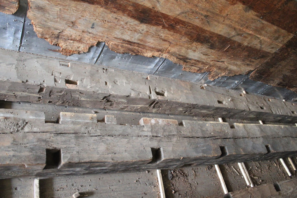 West gable tie beams, original and added. Later gable end tie is up top